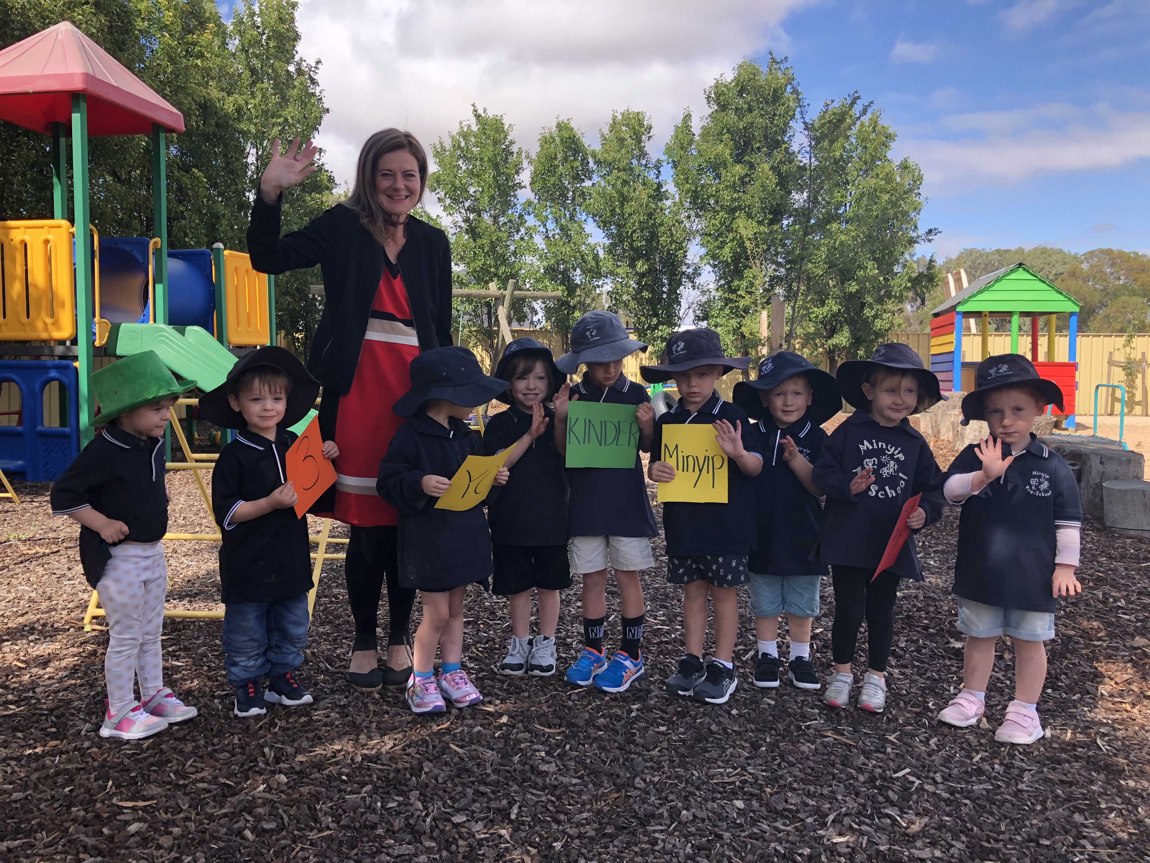 MP Sonya Kilkenny stand with a group of 3 year olds in a playgroundinder one of the leaders in the roll out of funded three-year-old kinder