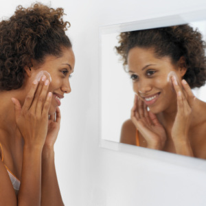 black-woman-looking-in-mirror-face-cream1.jpg