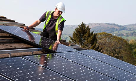 installing-solar-panels-on-roof.jpg