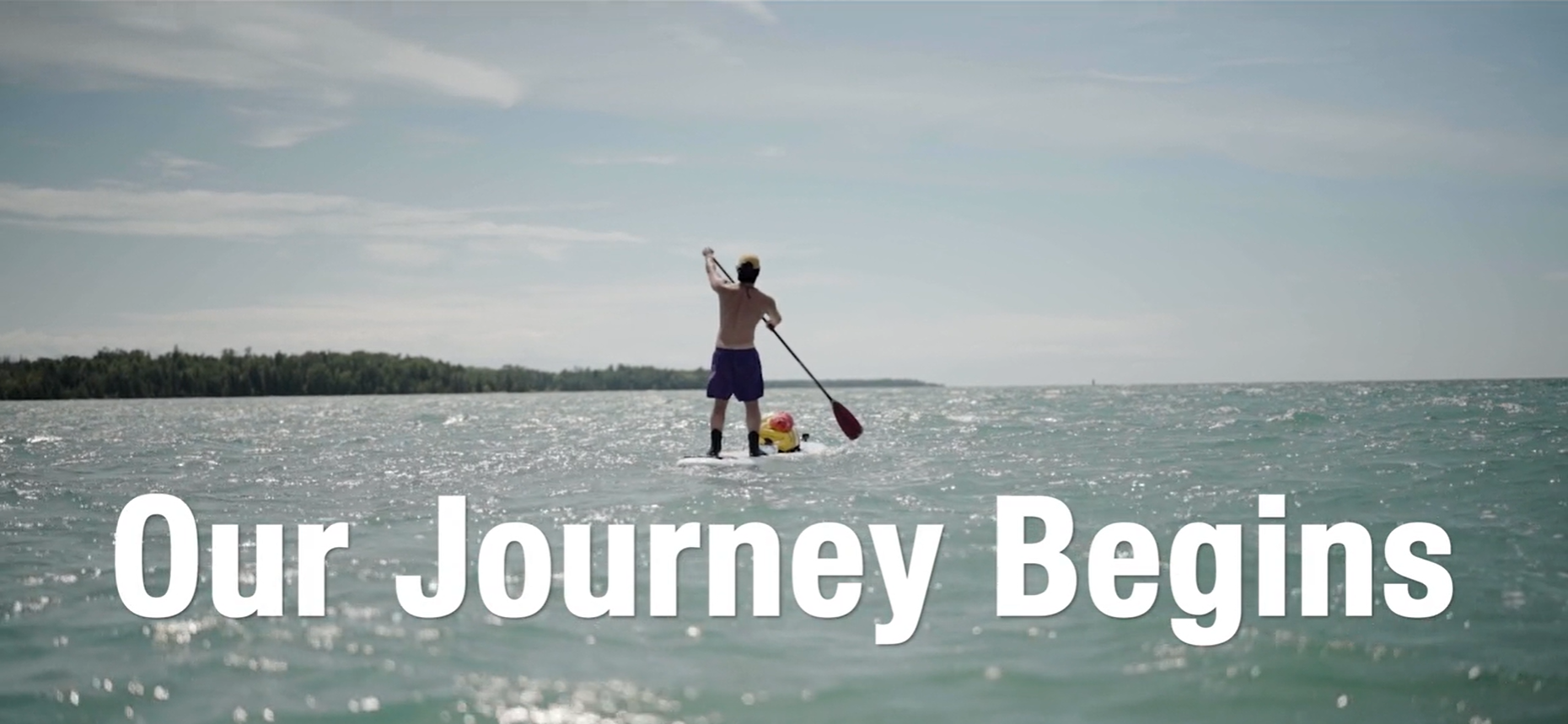 """Chris Yahanda, """"Troubled Waters"""" producer, paddle boards in Michigan"""