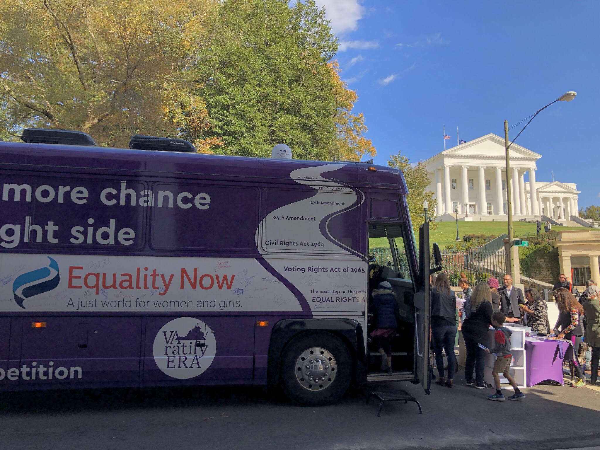 Photograph of a campaign bus parked outside the Richmond Capitol Building in Virginia