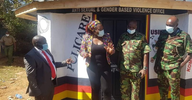 Four people stand outside the anti sexual & gender based violence office