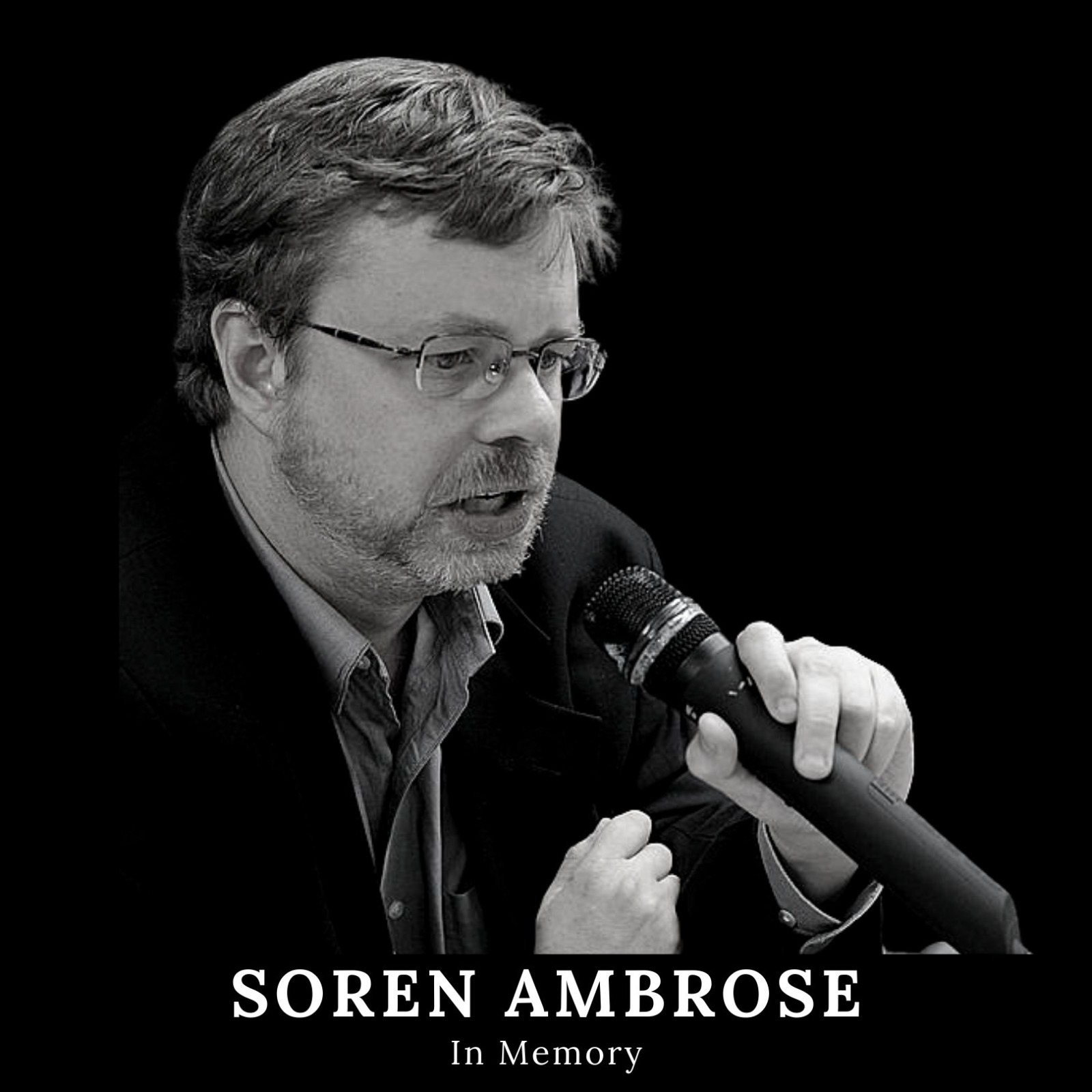 """A black and white image of Soren Ambrose with a microphone in his hand, calling for a fairer and more just world. Underneath the photo are the words """"Soren Ambrose: In Memory"""""""
