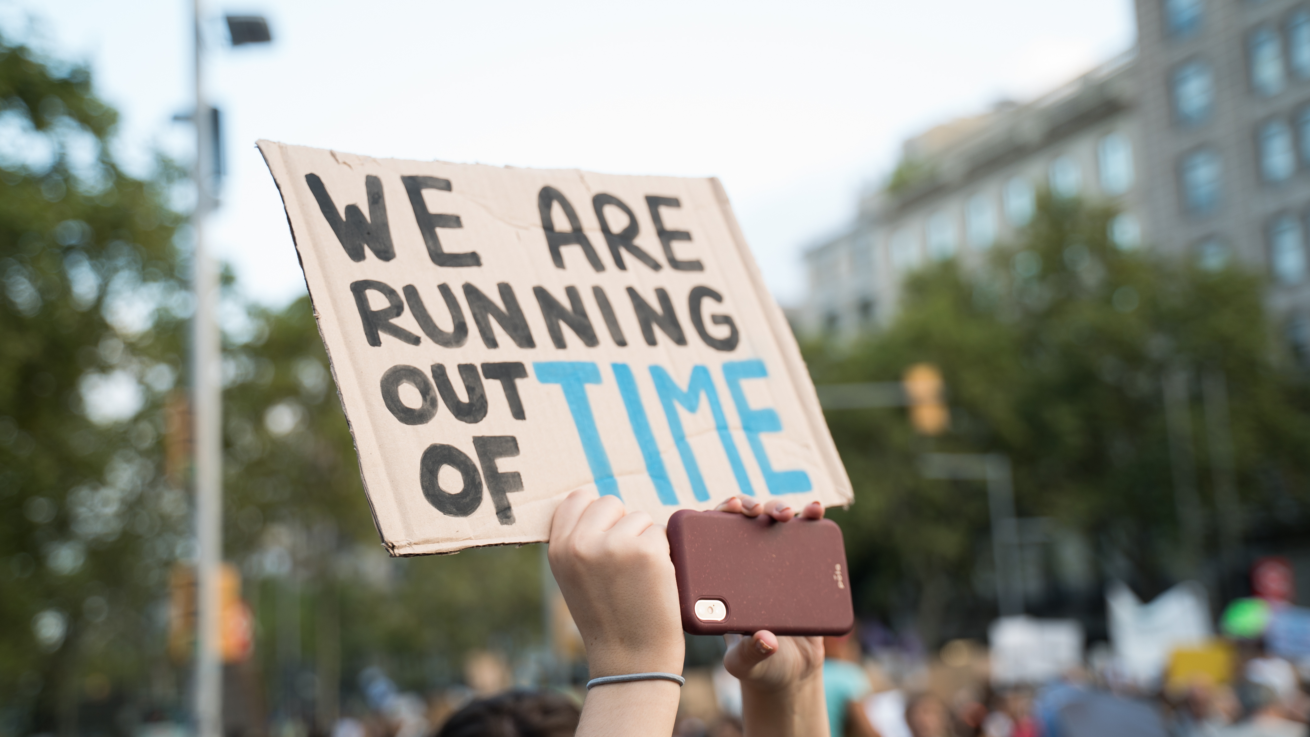 A protestor in Barcelona holds up a sign saying \