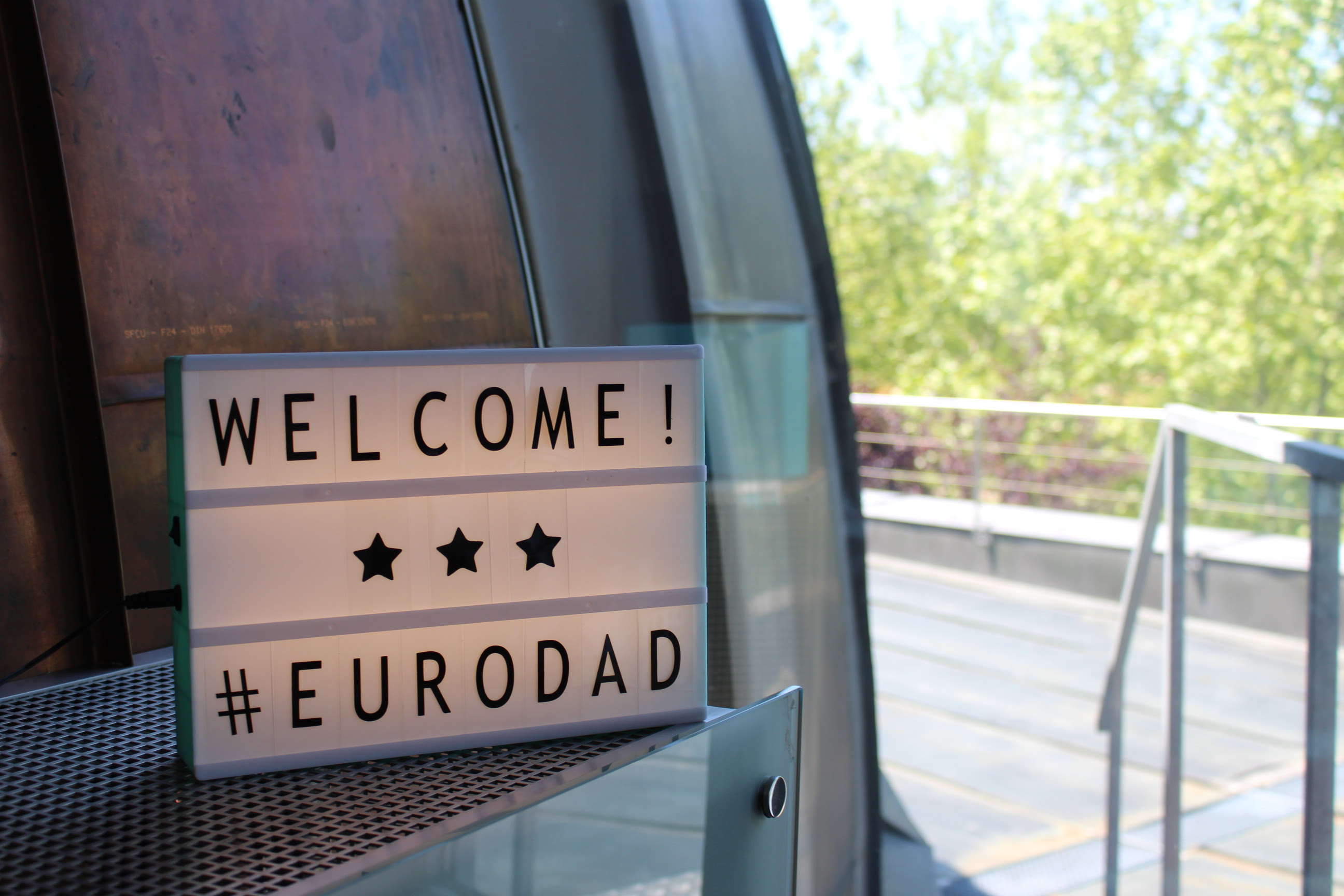 A small backlit sign reads Welcome! #Eurodad.