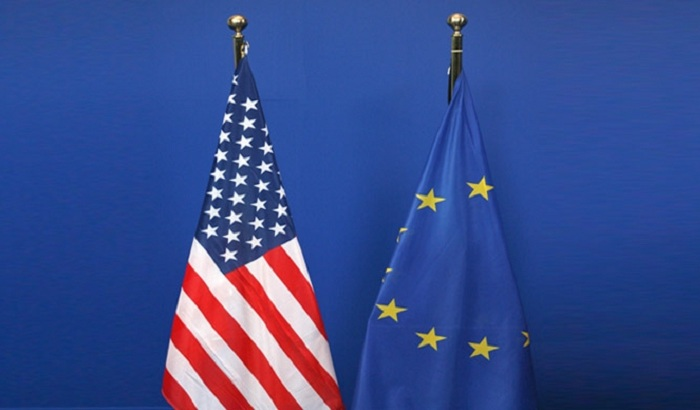 US-EU-flags-on-stand.jpg