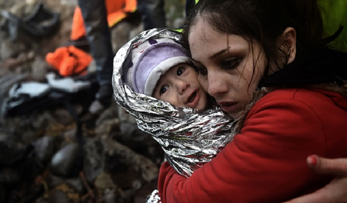 Woman-and-baby-refugees-asylum-700x410.jpg