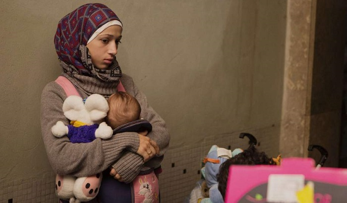 Woman-refugee-asylum-seeker-and-baby-700x410.jpg