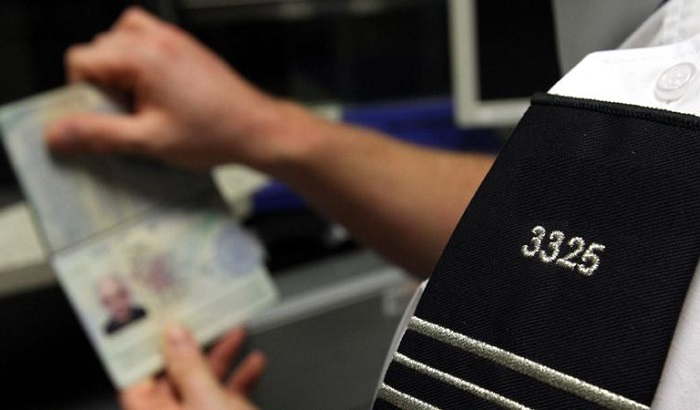 Officer-checking-passport-700x410.jpg