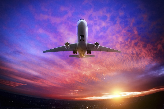 Airplane-at-Sunset-700x466.jpg