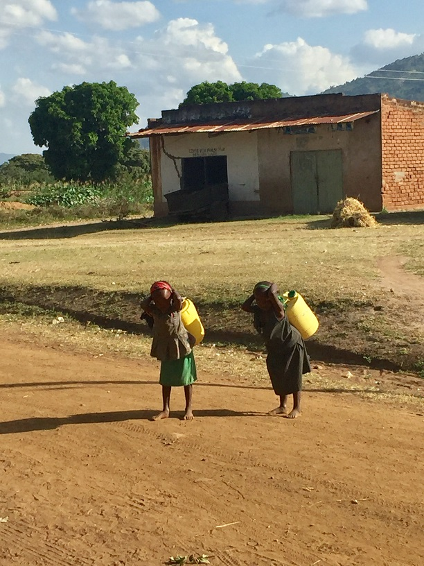 kids_carrying_water-red_size.jpg