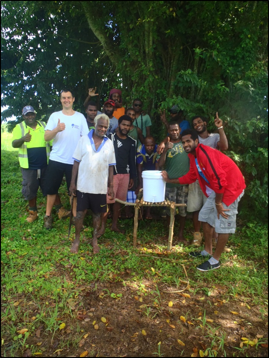 Community_members__CBSE_construction_with_a_simple_handwashing_station_next_to_the_Portable_Toilets.png
