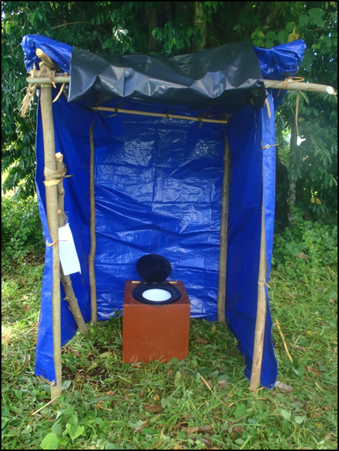 Portable_toilet_set_up_with_basic_shelter..png