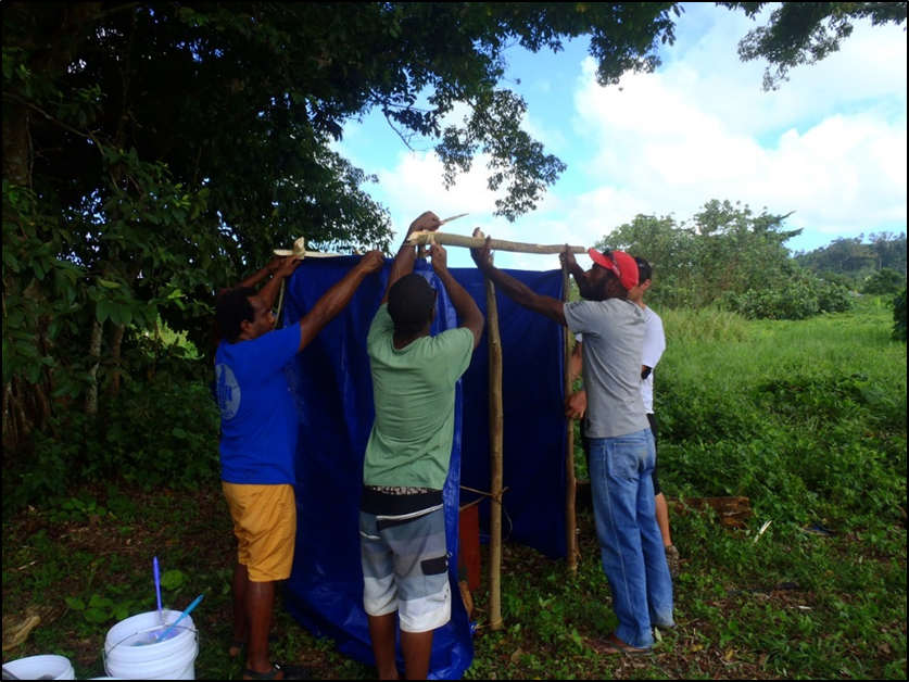 Building_a_basic_structure_around_the_Portable_Toilet_at_Teouma_Valley_Evacuation_Centre._-_Copy.png
