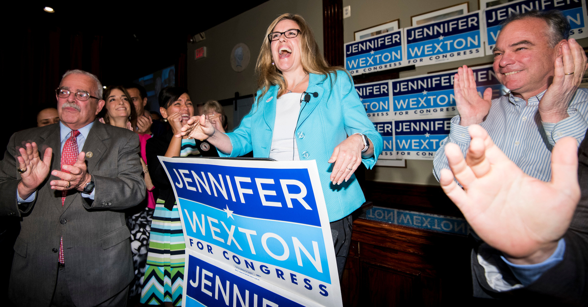 Virginia Democrat Jennifer Wexton, flanked by Rep. Gerald E. Connolly, left, and Sen. Tim Kaine, speaks at her 10th District primary night party at O'Faolin's Irish Pub in Sterling, Va., on Tuesday. She will next face Republican incumbent Barbara Comstock. (Bill Clark/CQ Roll Call)