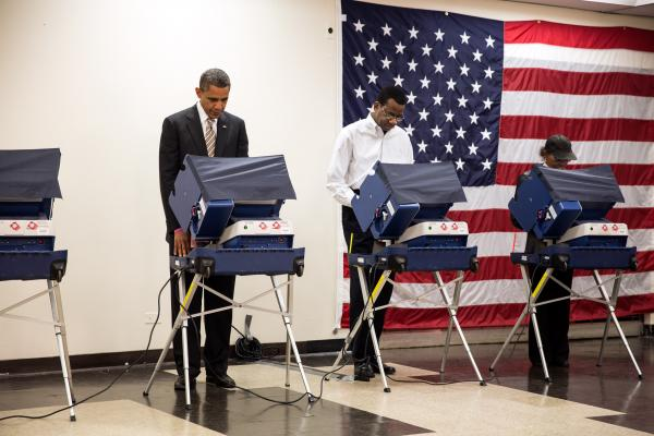 Barack Obama votes in the 2012 election.