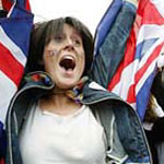 Woman rejoices as London is announced as the host city for the XXX Olympiad.