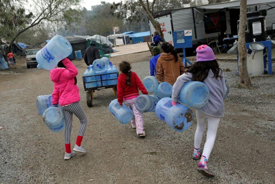 children-carrying-water.jpeg