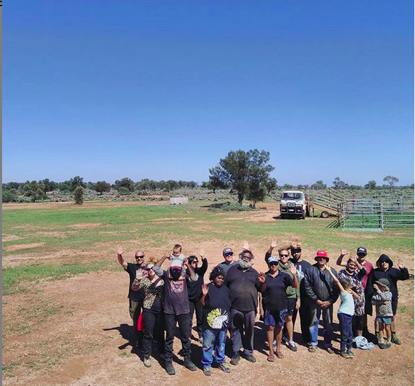 group of anti uranium activists stand together on cattle station