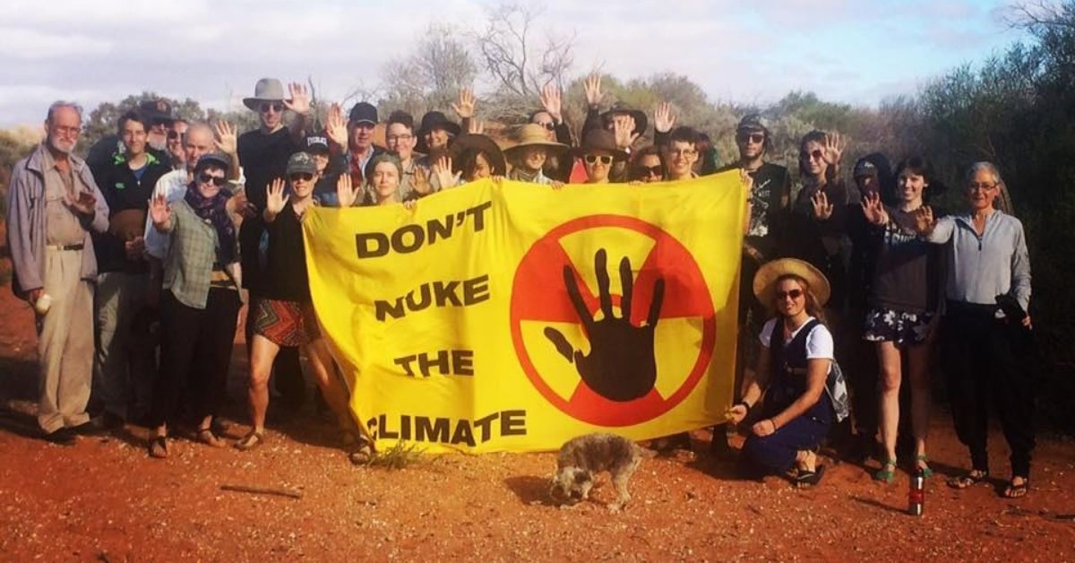 Don't Nuke The Climate Sign held by activists near Woomera