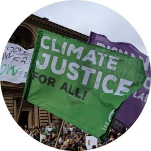 Climate Justice and Dismantle Patriarchy flags