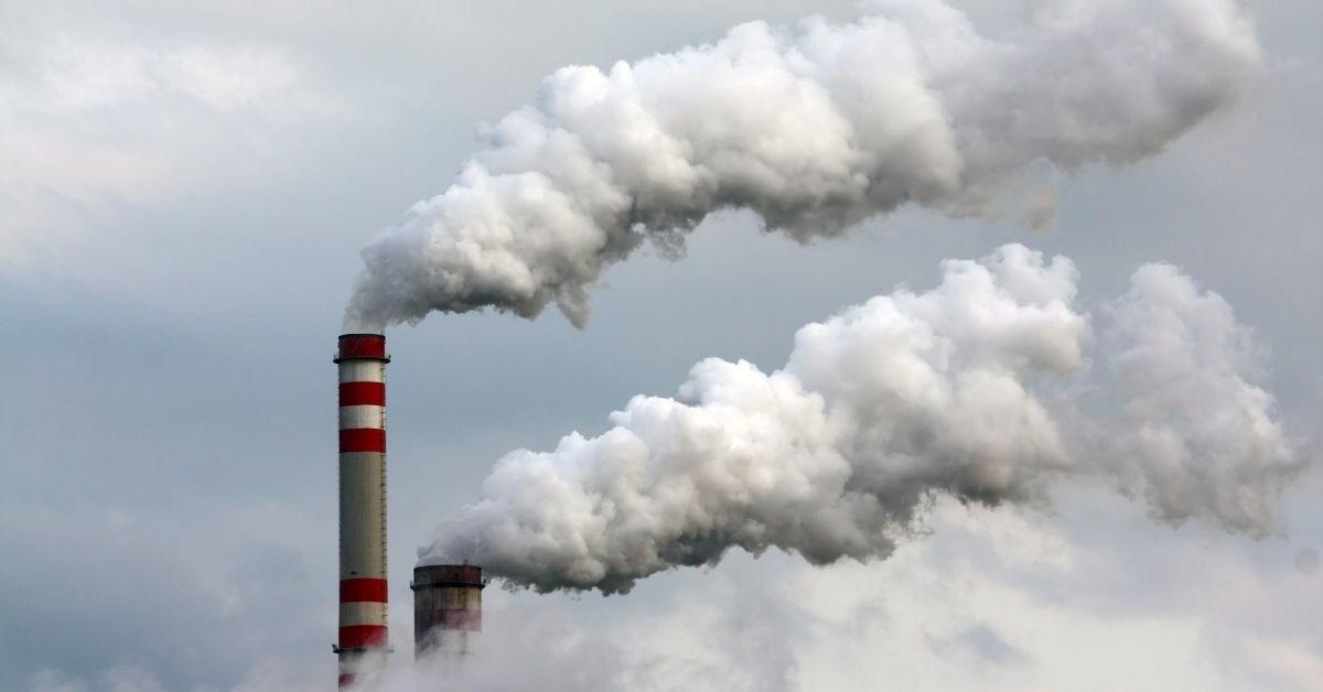 Smoke stack with smoke clouds
