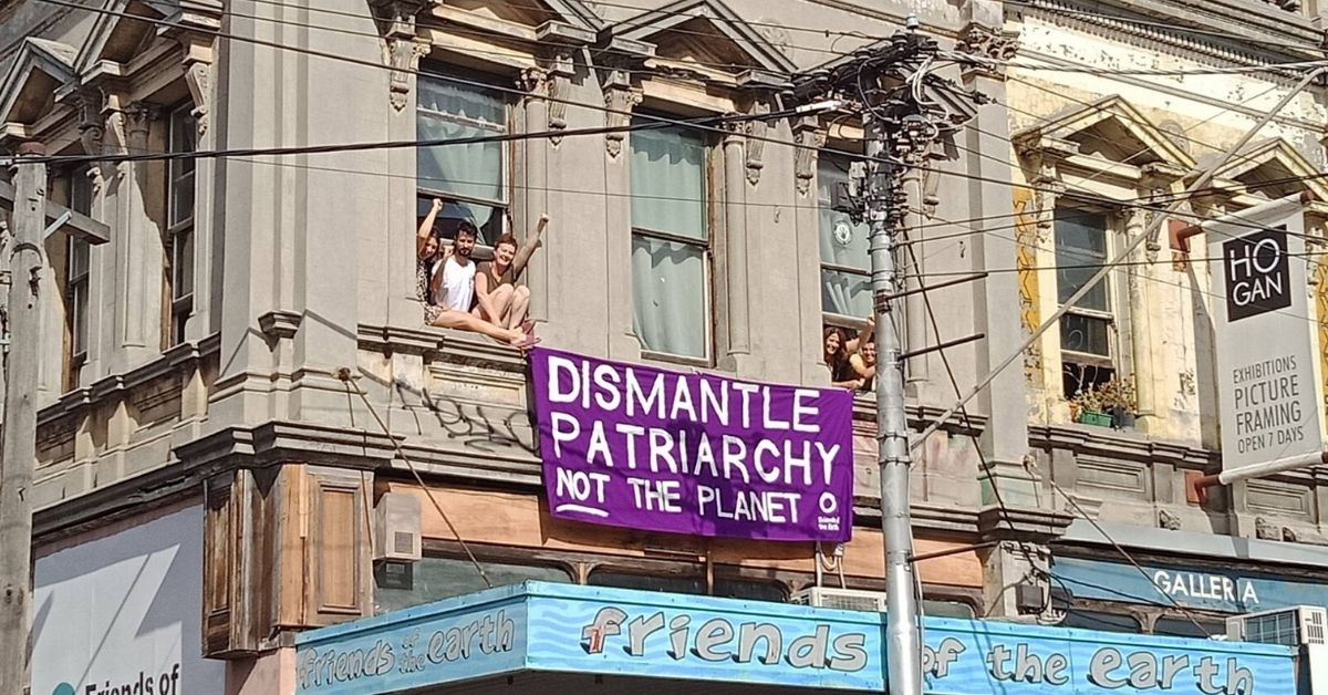 Dismantle Patriarchy not the Planet banner on the FoE Melbourne bulding