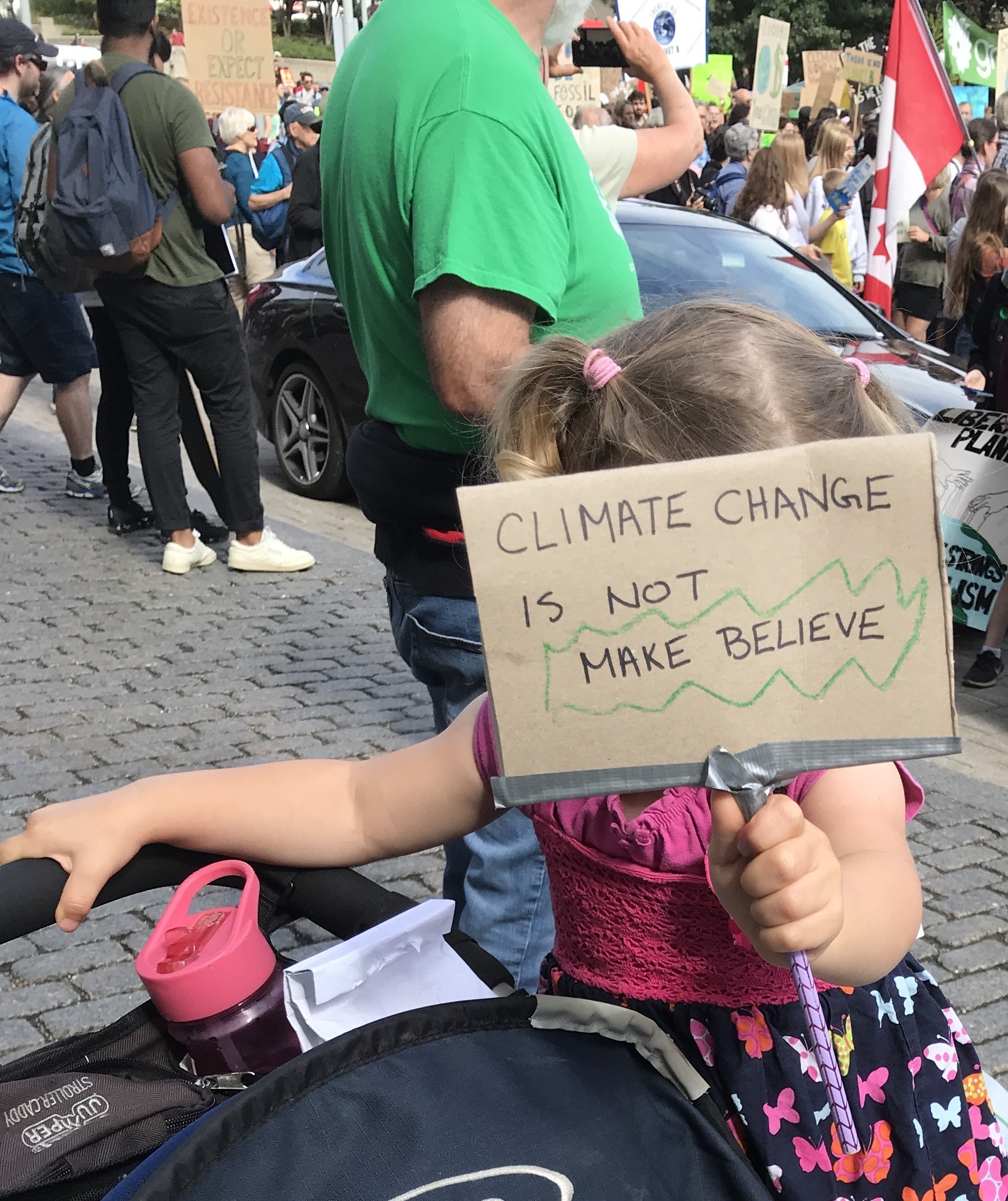 Sign saying Climate Change is not make believe