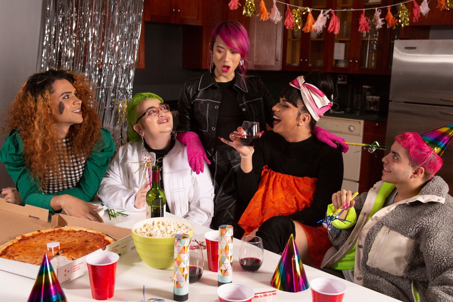 A group of friends of varying genders having a party