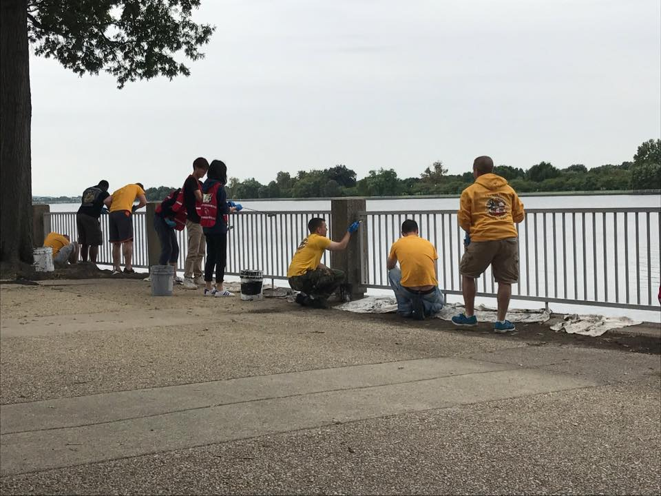 Volunteers painting the rails