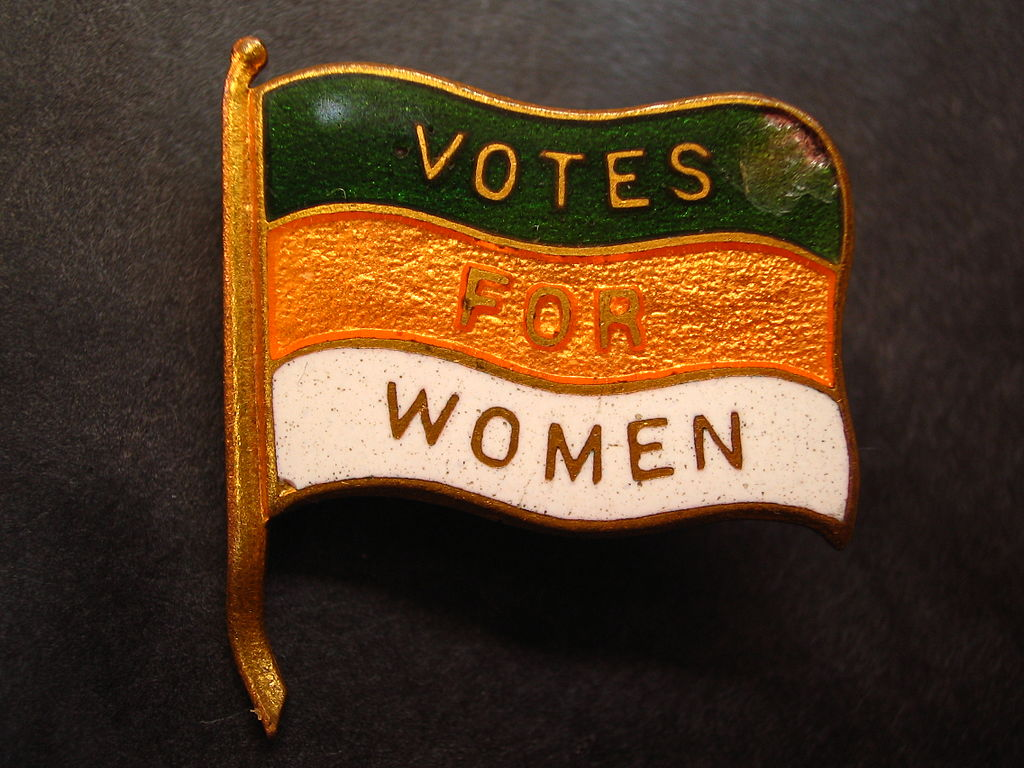 1024px-Votes_for_Women_lapel_pin_(Nancy).jpg
