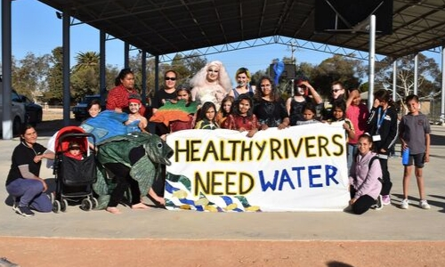 "Menindee Community - Banner reads ""Healthy Rivers Need Water"""