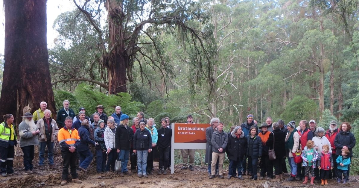 A crowd gather to celebrate the new Brataualung Forest