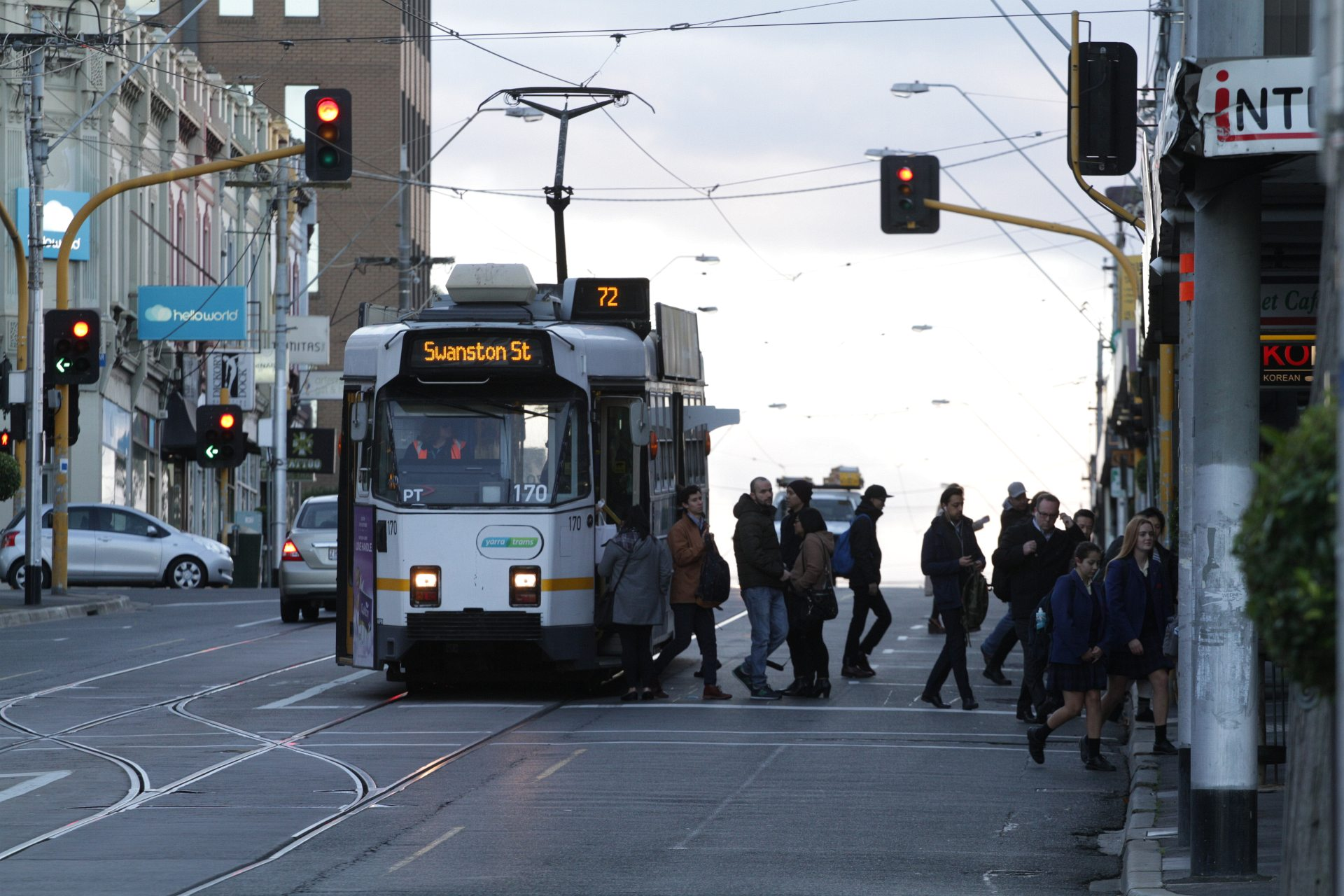 Melbourne tram with passengers disembarking