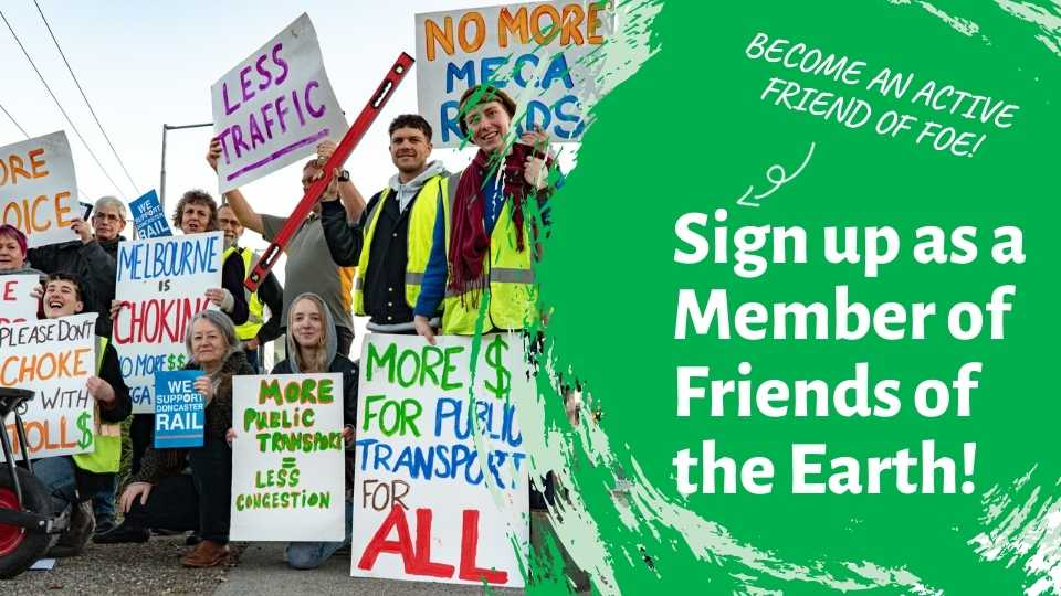 A group of people hold placards at a non-violent protest in relation to transport. Text overlay reads: Sign up as a Member of Friends of  the Earth!