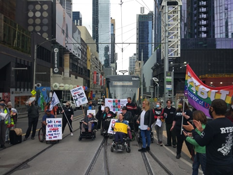 People block a tram in Melbourne's CBD