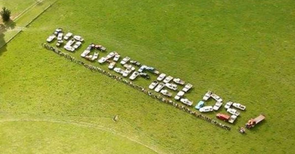 'No Gasfields' spelled out with utes in a field