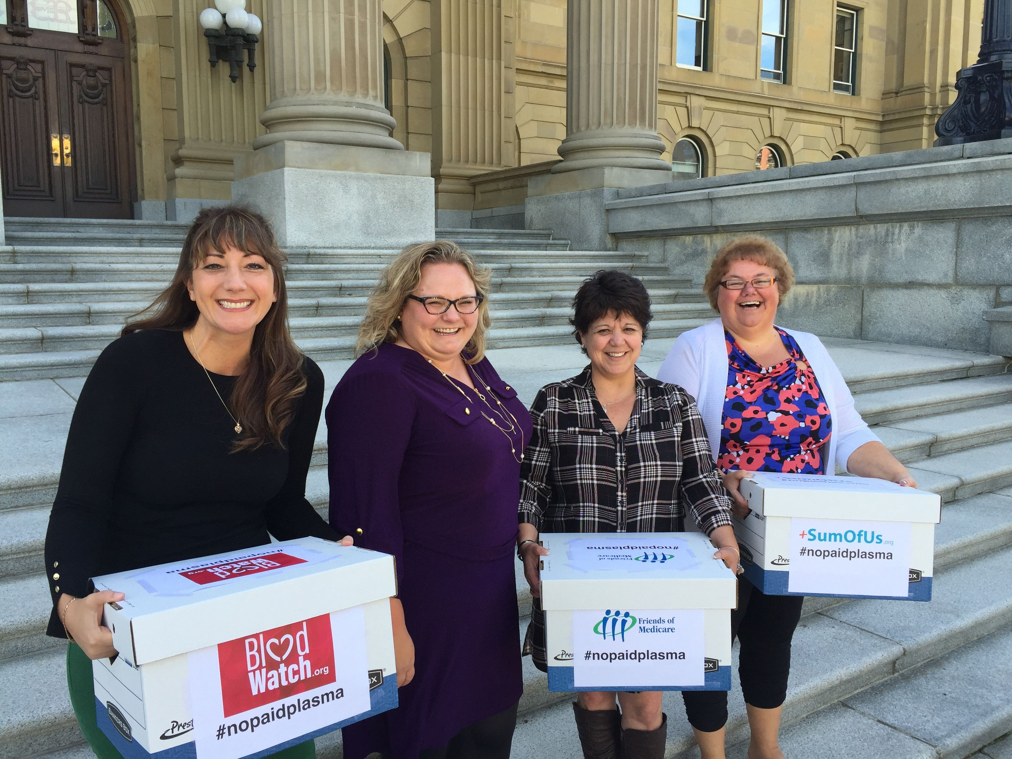 Sandra Azocar, Kat Lanteigne with BloodWatch.org & CUPE Alberta President Marle Roberts presenting petitions to Minister Hoffman calling to ban the sale of plasma.