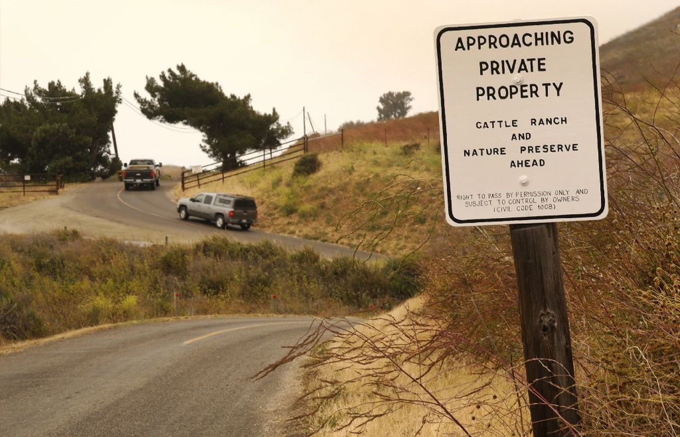 Vehicles navigate the narrow, curvy Hollister Ranch Road with signs warning of trespassing. In a settlement agreement with the homeowners association, state coastal officials agreed to give up its claims of public access by land. (Al Seib / Los Angeles Times)