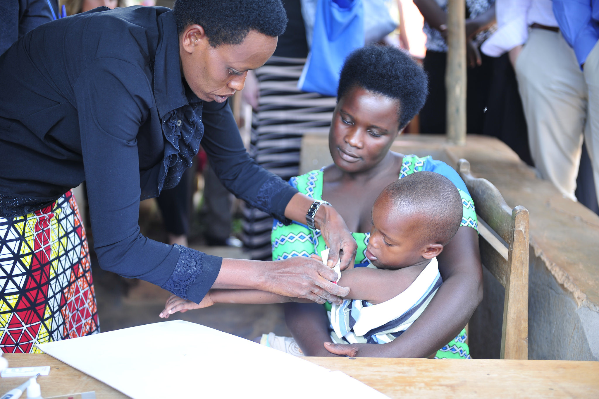 Health care worker assisting a child