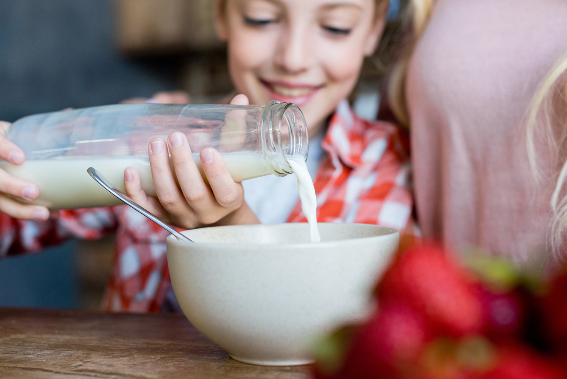 Girl eating a bowl of cereal