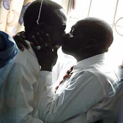 Kenyan LGBT men kiss