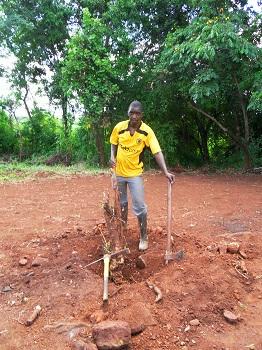 Mozambique_-_Pastor_Edmore_pulling_stumps.jpg