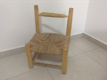 Haiti_-_hand_woven_chair_Fall_2015.jpg