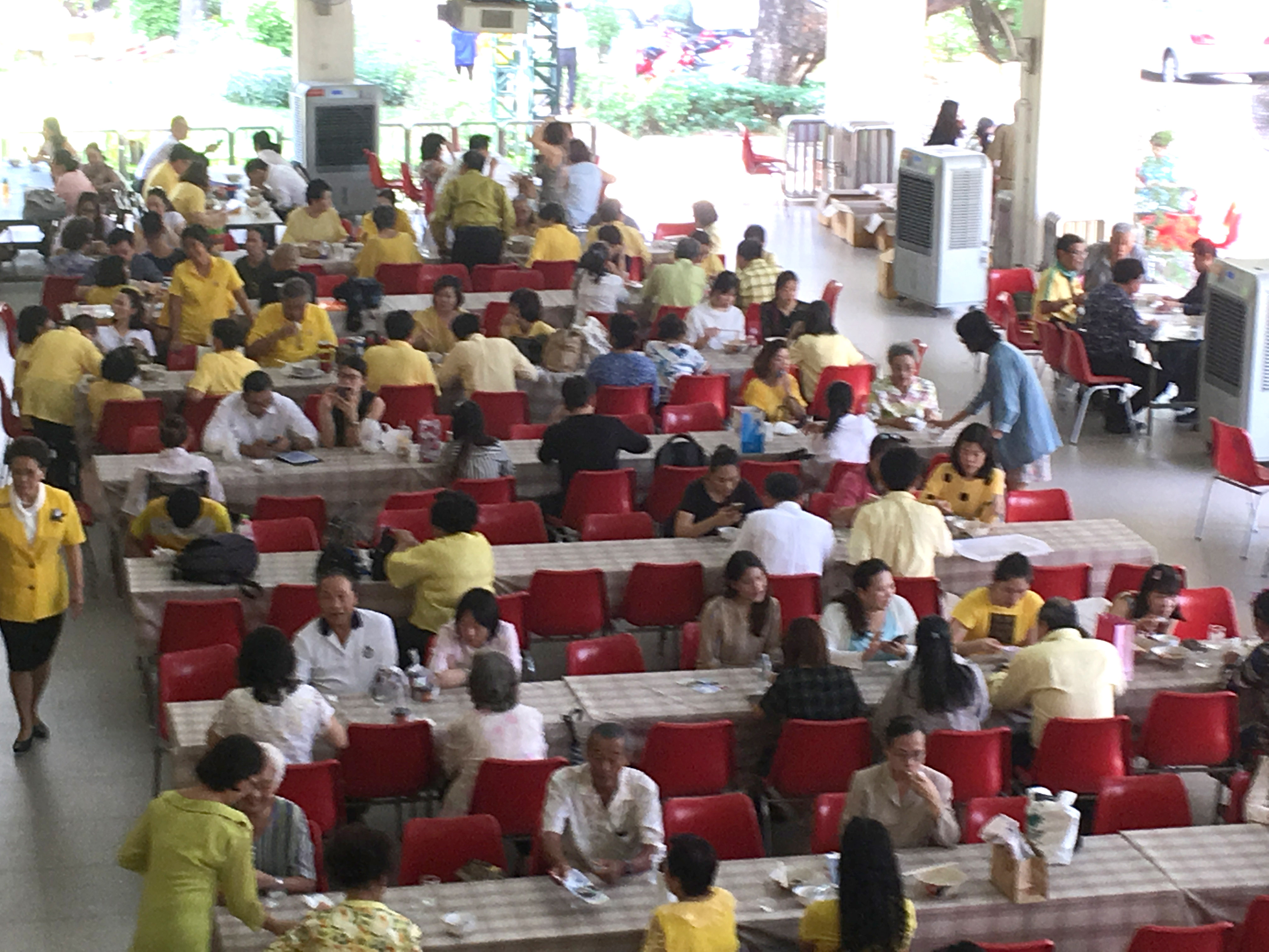 Thailand_Anne_Gregory_The_Beloved_Community_-_Sunday_lunch_-_yellow_shirts_honor_the_new_King.jpg