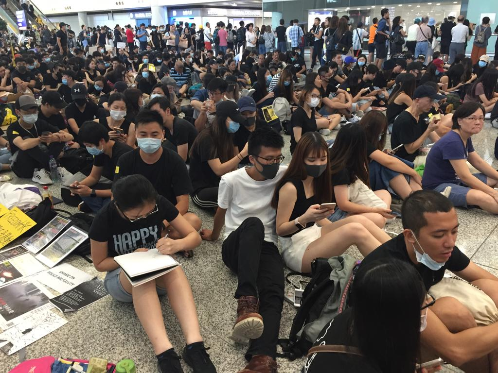 Hong_Kong_Judy_CHan_protest_at_airport.jpg