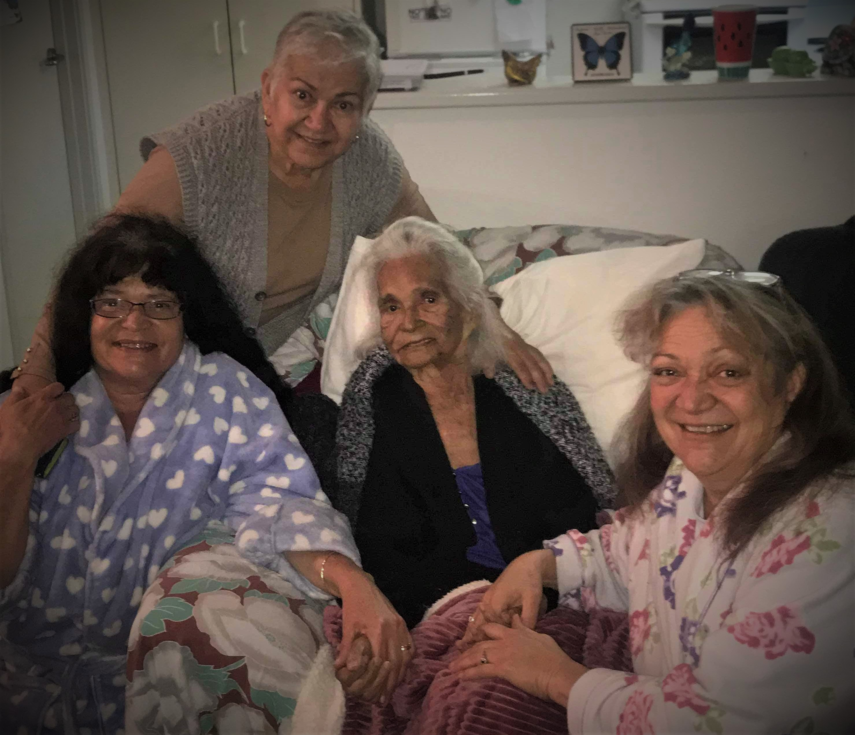 Elvie Holly (centre) with three of her four daughters