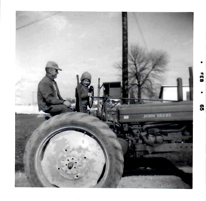about_with_dad_on_tractor.jpg