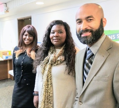 Dario Hunter, Vice President of the Minneapolis Park Board Latrissa Vetaw and Minister Toya Woodland