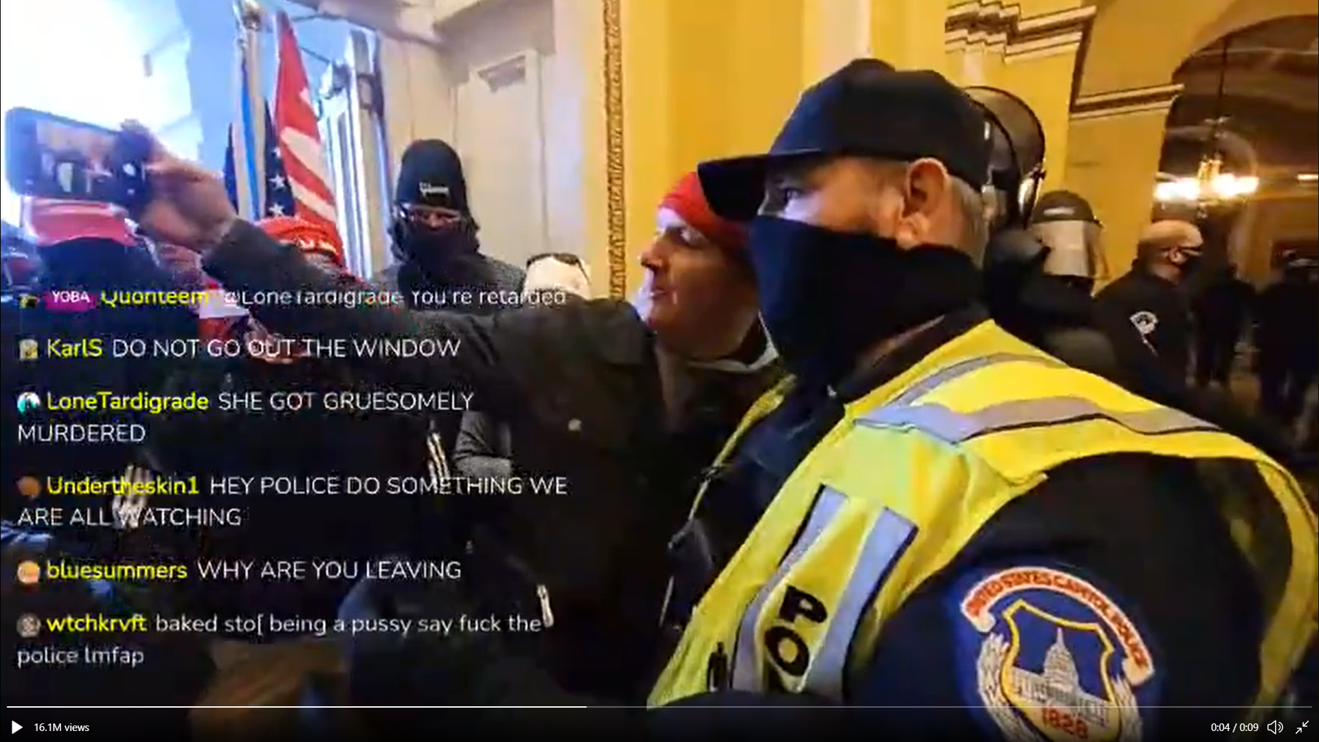 A livestream screenshot of a cop taking a selfie with someone illegally inside the Capitol building.